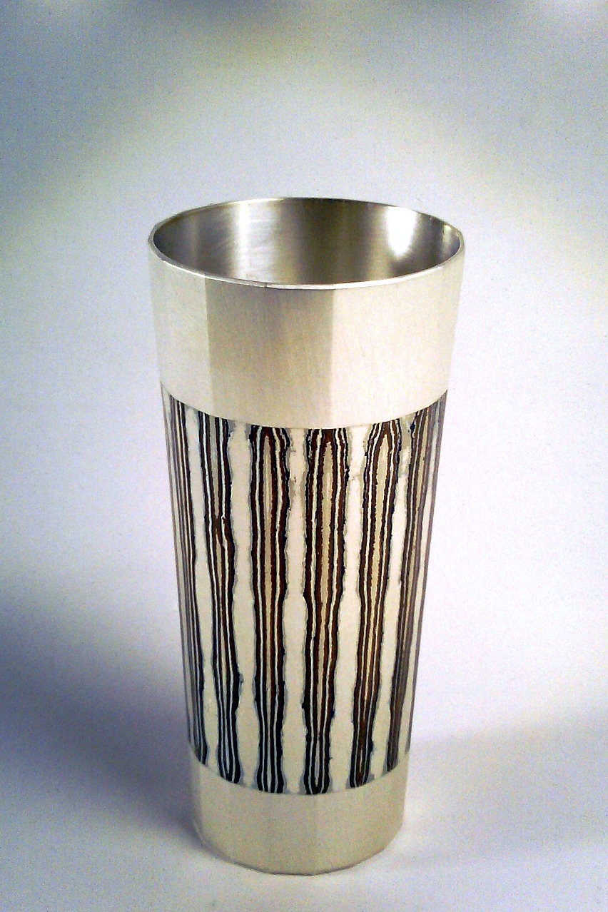 Fabricated Mokume Gane Beaker made from 7 layers of silver copper and gilding metal. Ht11cm Dia 4.5cm