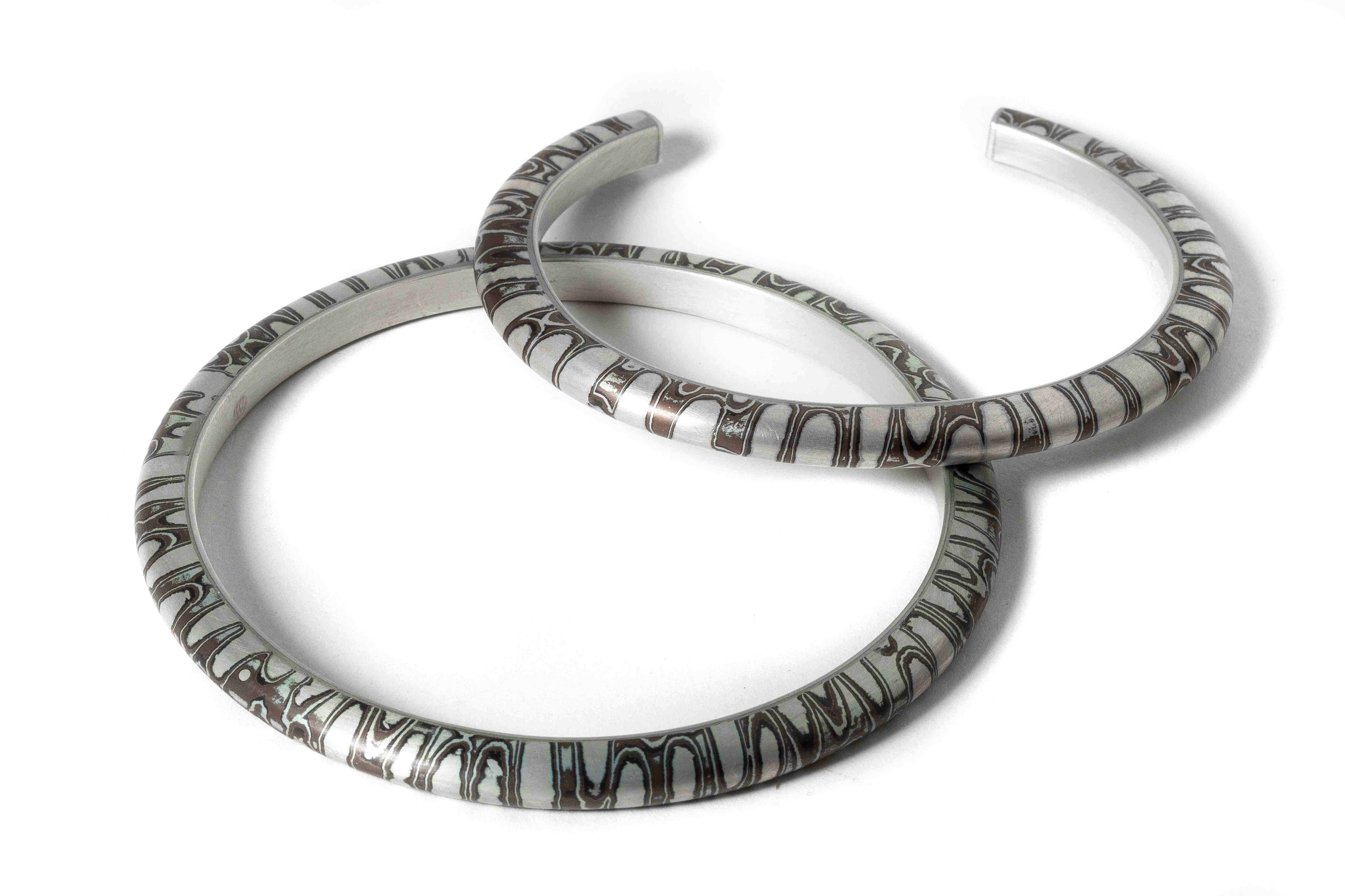 Mokume Gane Bangles made from 7 layers of silver copper and gilding metal
