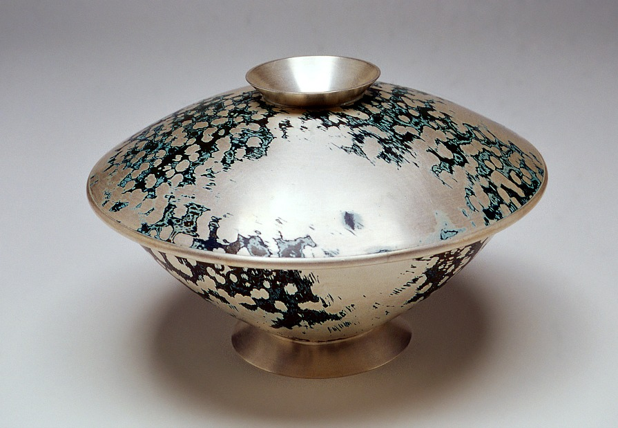 Mokume Gane Container for olives, nuts, etc. The lid reverses to become a receptacle for stones, shells, etc. Made from 7 layers of silver, copper and gilding metal. Ht 8cm, Dia 15cm
