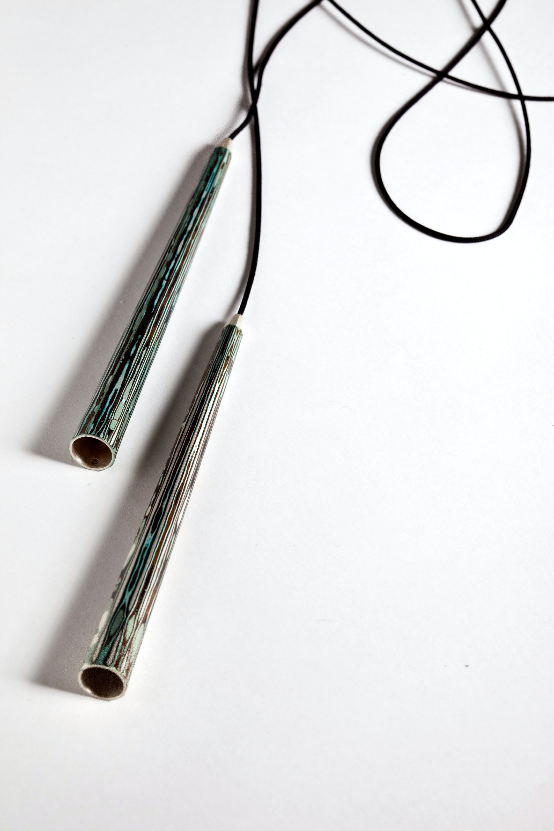 Mokume Gane Lariat made from 7 layers of silver copper and gilding metal with a silk cord